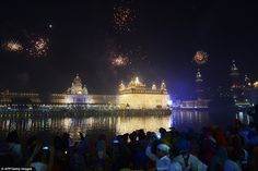 Indian Sikh devotees watch a fireworks display during Bandi Chhor Divas, or Diwali, at the...