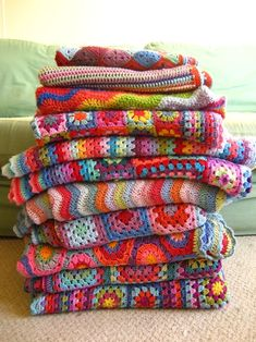 I must learn how to create a granny square blanket...I absolutely love the variety of colors & patterns!