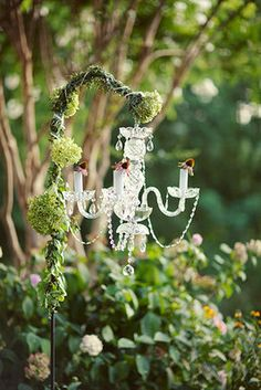 Chandelier decor for the altar {Photo by Jodi Miller Photography via Project Wedding}