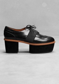 & OTHER STORIES Made from leather, these brogue-like platforms have a modern, masculine edge.   - Lace-up front, covered by a wide elastic strap - Wingtip style design around the toe cap - Prominent welt - Suede platform and heel - Cushioned leather insole and a leather and rubber outsole - Heel height: 7.5 cm
