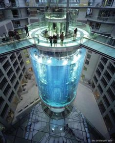 A German hotel that has an elevator in the middle of an aquarium!