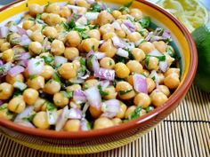 Indian chickpea salad Serves 4, preparation time: 20 minutes, only 193 kCal per 100 grams Ingredients 2 cans of chickpeas in water, drained 2 red onions, peeled and chopped Juice from 1 lime 2 cloves of garlic, finely chopped 1/2 teaspoon ground cumin 3 tablespoons of olive oil 1 pinch of paprika 2 pinches of sea salt small bunch of chopped fresh coriander