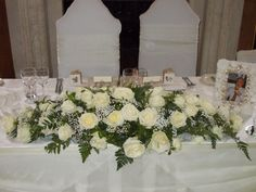 Gorgeous top table flower arrangement in the Ballroom