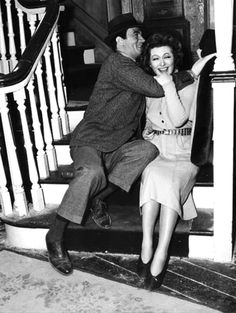 Candid shot of Greer Garson and Walter Pidgeon on the set of Mrs. Miniver (1942)