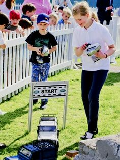 yoursweetremedy:   James, Viscount Severn, and Lady Louise race cars at the Royal Windsor Horse Show, May 14, 2014