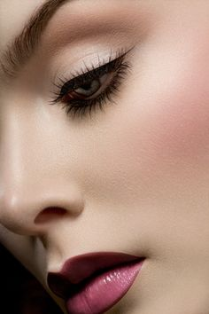 Love the porceline skin, plum lip, and black eyeliner look. Lighten it up, and it would be even pretty for day makeup.