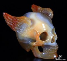 Winged skull carving of sardonyx (red banded agate or carnelian). Wow!