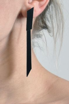 contemporary earrings made of double face leather http://aumorfia.com/shop/puzzle_double/#sthash.6sPiTTfo.dpuf