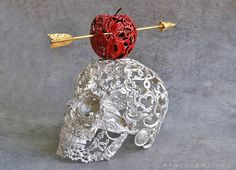 Lace skull with apple- Might be able to do this with glue and lace over a head form...