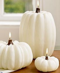 Beautiful white pumpkin candles ~ I don't think I could use/light them.