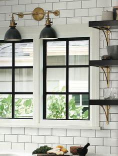 Everybody loves subway tile; it looks so airy and clean in a kitchen. But instead of using white grout, the trend is pointing to using gray, like in the Rejuvenation catalog, which looks clean and cool with its stark contrast.