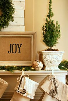I love everything about this beautifully decorated room burlap, frames, mantel, christmas decorations, christmas quotes, letters, stencil, mantl, cross stitches