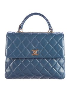 In Stores Now. From the Fall 2016 Collection. Blue quilted lambskin Chanel Trendy CC Large Flap bag with gold-tone hardware, rolled top handle, leather and chain-link shoulder strap, logo details at front, back exterior slit pocket, burgundy leather lining, three interior compartments, three wall pockets; one with zip closure and turn-lock closure at front flap. Serial number reads 23251470. Includes box and dust bag. Shop authentic designer handbags by Chanel at The RealReal.