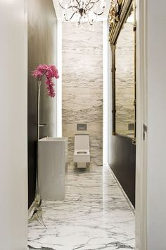 Powder Room - Elegant marble adds great impact to this small gorgeous powder room.....the red bloom adding a touch of colour.
