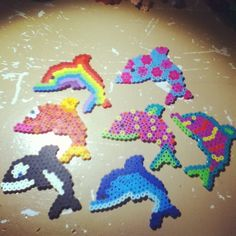Dolphins and an orca perler beads by Tiara Cunningham