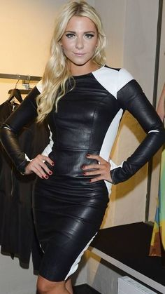Blonde in fitted black and white leather minidress