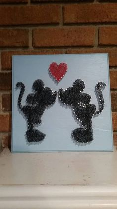 A personal favorite from my Etsy shop https://www.etsy.com/listing/288508381/mickey-and-minnie-string-art-in-love