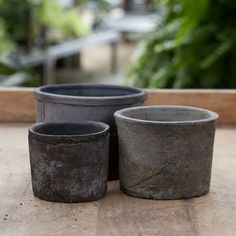 """$4-6 , Using a traditional aging process, these handmade pots are wrapped in linen, then stowed in a root cellar for several months to develop a textured patina atop a matte, slate finish.- Handmade, variation will occur- Clay- Indoor or outdoor use- Drainage hole included- ImportedSmall: 3""""H, 4"""" diameterMedium: 4""""H, 5"""" diameterLarge: 5""""H, 6"""" diameter"""