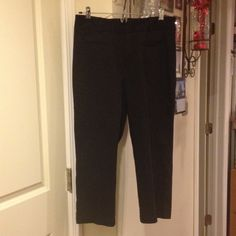 Black Capri pants Start getting ready for summer. Black Capri pants.  Can be worn anywhere. 2 pockets in the front and zipper, inside button with 2 sliders Dockers Pants