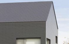 Vertigo is the UK's first fibre cement slate, specifically designed for vertical cladding applications. Available in a range of colours and textures. Concrete Roof Tiles, Clay Roof Tiles, Cement, Roof Cladding, Slate Roof, Vertigo, Facade, Skyscraper, Multi Story Building