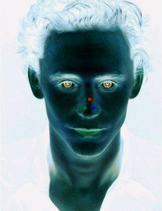 Look at the red dot for 30 seconds, then look at a wall and blink.