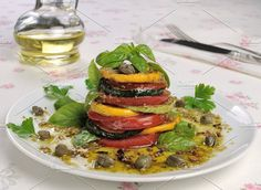 Appetizer of zucchini with tomato Photos Appetizer of zucchini with tomato, pesto and capers by Apolonia