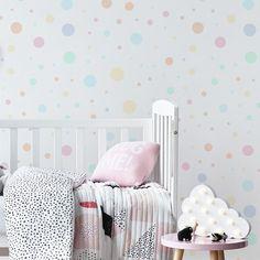 A jumbled arrangement of pastel polka dots in various sizes.