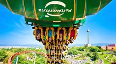 many people enjoying roller coaster ride at Port Aventura Park in Barcelona