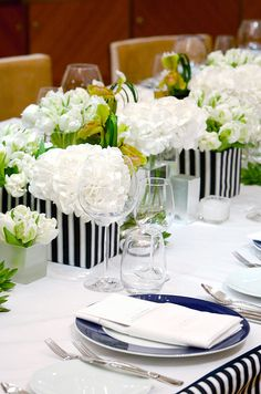 How elegant are tulips and hygrangeas in navy blue and white containers?