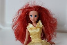 How to revive Barbie's frizzy hair...simple enough..
