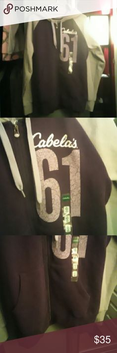 New Cabelas women's zip up hoodie Bought for my daughter and she never wore it. Beautiful purple and grey heavy weight zip up hoodie size medium from the famous Cabelas outfitters. Make an offer! Cabelas Tops Sweatshirts & Hoodies