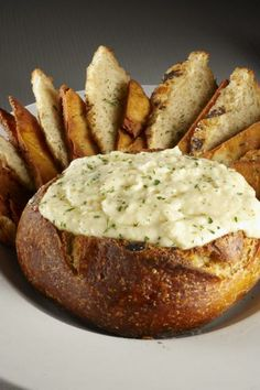 Vampire Dip @ Slater's 50/50...  VAMPIRE DIP    2 cups grated parmesan or romano cheest  1 cup grated mozzarella cheese  1 cup mayonnaise  1 can (14) oz artichoke hearts packed in water, drained  1 whole, yes WHOLE POD (not a clove) garlic minced    Mash all ingredients together in a casserole dish.   Bake in 350 oven for about 45 minutes covered then uncovered for about 10 minutes OR    Microwave 10 to 15 minutes until hot and bubbly    Serve hot with bread or vegetables