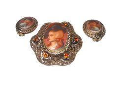 1950's West German transferware cameo brooch with orange rhinestones and clip-on earrings. $39.00, via Etsy.