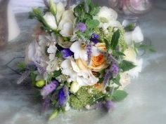 My hand-tied wedding bouquet, created by Rachel at the English Rose Florist http://www.englishroseflorist.co.uk/index.shtml. A delicate, whimsical, romantic look with whites, lilac, blues and peach. Mint, freesias, anemones, peach roses and lisianthus.