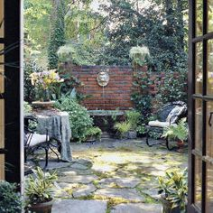 Classic Courtyards | Shady Courtyard | SouthernLiving.com French Courtyard, Small Courtyard Gardens, Courtyard Landscaping, Small Courtyards, Back Gardens, Outdoor Gardens, Brick Courtyard, Courtyard Ideas, Small Patio
