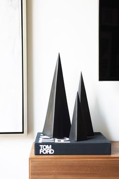 Sculptures styled on coffee table book in living space