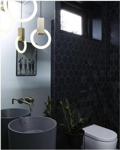 A mood design that marries elegance and luxury. The Matiere honeycomb tiles add depth and dimension to this dark and sophisticated bathroom. Product — Matiere Bathroom Lighting Design, Bathroom Wall Lights, Bathroom Light Fixtures, Bathroom Faucets, Home Lighting, Lighting Ideas, Bathrooms, Industrial Lighting, Bathroom Designs