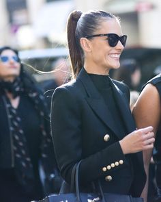 Black blazer and black slight turtle neck shirt with a black Hermes Street style Paris fashion sleek ponytail simple fashion