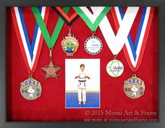 An artistic arrangement of medals on red suede with a photo of the little athlete; overlapping the ribbons allows for effective display that doesn't become overly large.