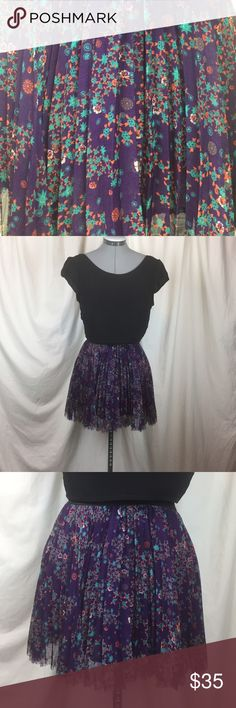 "Free People purple floral skirt This is such a cute skirt, just too small for me. Purple pleated layered mini with red, blue and white flowers. 13"" elastic waist 14"" length. Size is medium but I'd say it runs small. Free People Skirts Mini"