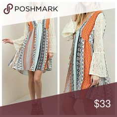Multi-Color Dress With Lace Sleeves Dress is loose and flowy, in mixed colors of deep orange, light blue, black, and cream. EVIEcarche Dresses