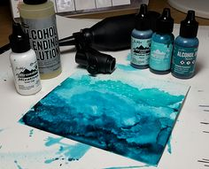 By Jane. Coat 200gsm Yupo with blending solution; then drizzle on alcohol inks - aqua, pool, stream. Tip paper in various ways. Add air (straw, canned air, marker spritzer). Finally, add snow cap alcohol ink and move with air. Go to her website for more details and photos plus her finished card.