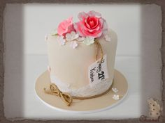 Rustic & elegant cake.......................1 tier round (7 inch - extra tall) Cake, Covered in tan fondant and decorated with white lace & twine rope around the base of the tier, Fondant Happy # Name tag, and pastel coloured fondant flowers, topped with medium & large pink sugar roses.