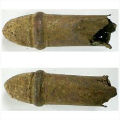 """.54 Burnside Cartridge  Description: This .54 Burnside Carbine bullet is in great shape but the cartridge has cracked towards the bottom. The hull is still full of powder and is crushed on the end.  Measures: L2""""  Recovered: Hauser Farm, Sharpsburg, Md."""