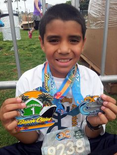 "Three cheers for Exceeding Expectations student, Saul! At just 11 years old, he earned the ""Beach Cities Challenge"" award for completing three half marathons: Long Beach, Surf City, and OC. Please join us in congratulating him!"