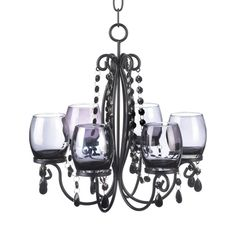 Black Elegant Chandelier - The glow of a sultry evening can be yours whenever you want. This chandelier's faceted baubles dangle and reflect the sparkle of six candles set in tinted glass creating the perfect ambiance for a romantic getaway right in your own home.