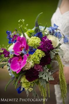 Wedding bouquet designed by Hilltop Florist and Greenhouse. Stunning summer wedding bouquet.