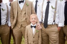 Vintage Khaki Suits. Groom in a suit and groomsmen in suspenders