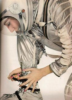 Harper's Bazaar, April 1965.  A perfect example of space age fashion editorials from the '60s: models wearing real NASA space suits.