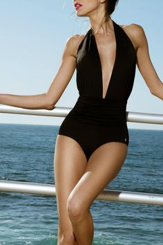 Sophisticated-sexy one piece Eva flatters your figure with a ruched bodice and plunging neckline, in black.   Black One Piece by Sauipe. Clothing - Swimwear - One-Piece California